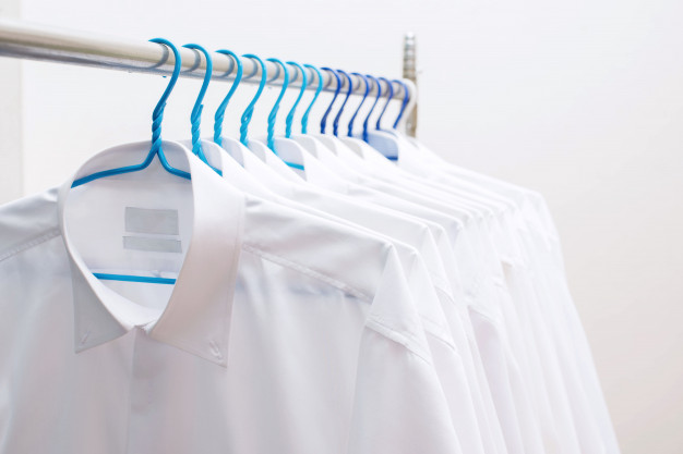 white shirts hanging rack row 37750 50